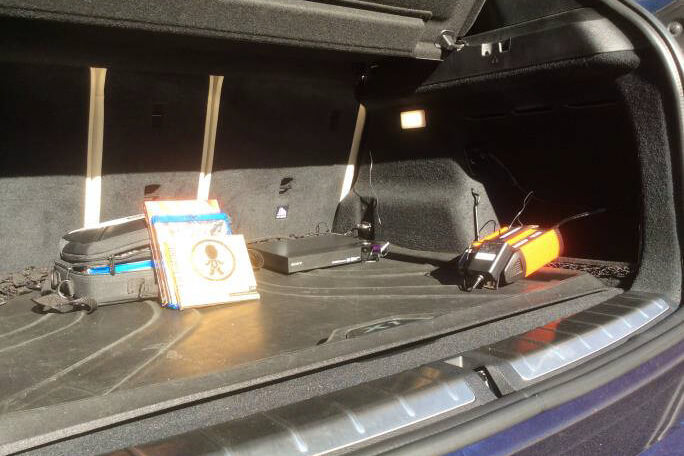 A Sony Blu-ray player in the trunk of a BMW X1