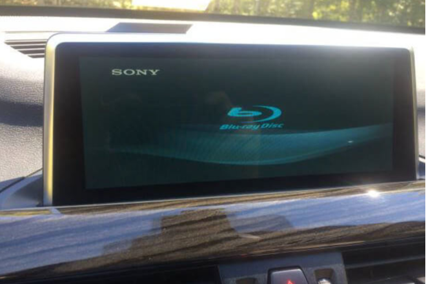 A 2016 BMW X1 F48 iDrive with a Sony Blu-ray player